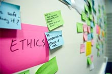 postits on a wall highlighting the word 'ethics'