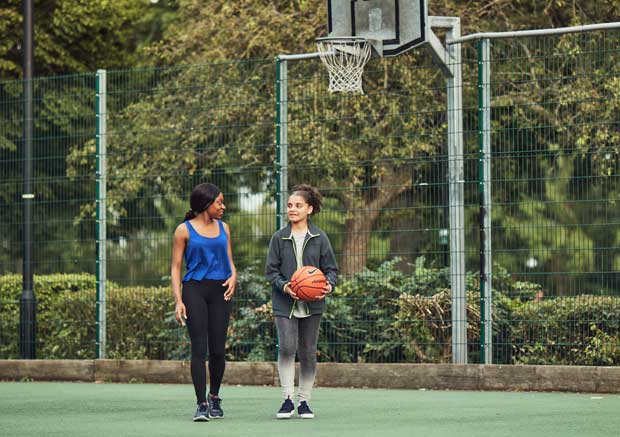 two girls and basketball